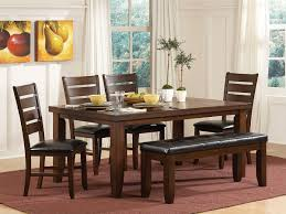 charming rustic indoor dining room with dark brown oak wood rectangulare and chairs round that tuck