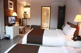2 double beds. Modren Beds Motel Le Radisson De Valdavid  Deluxe Double Room With 2 Beds And In Double Beds I
