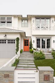 white interior front door. Orange Front Door. Beach House With Off White Siding, Light Interior Door R