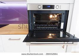 open oven in kitchen. modern kitchen with open oven in