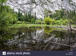 Granite Wall granite wall reflected in mirror lake in yosemite national park 4636 by xevi.us