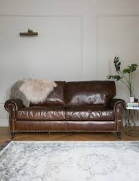 leather sofa antique chairs vine