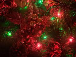 red and green christmas wallpaper. Modren Green A Closeup Of A Christmas Wreath With Red And Green Lights Inside Red And Green Wallpaper O