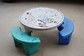 image of round plastic picnic table