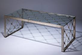 wrought iron net coffee table in distressed silver leaf finish with glass top