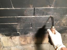 clean old loose mortar from fire brick joints