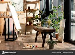 interior artist studio painting supplies potted plants bench stock photo