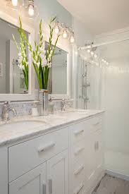extravagant small bathroom lighting 12 with white cabinets under two sinks wooden framed mirrors ingenious design ideas small