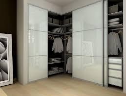 Modern Closet with Frosted glass sliding closet doors, Bamboo flooring,  Modu