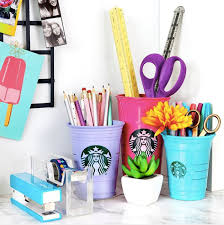 so you ve gone on a starbucks run almost every day this week and now you have a huge pile of frappe cups before you trash em try this awesome diy desk