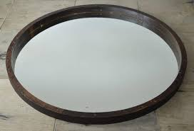 good size understated round mirror the only ornament is 14 neatly positioned s on the