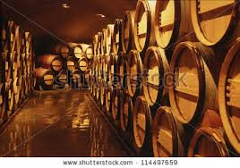 stacked oak barrels maturing red wine. Wine Barrels In Cellar. Cavernous Cellar With Stacked Oak For Maturing Red A
