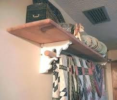 curtain rod shelf quilt hanging brackets wooden closet hanger and combo bracket adjule support r closet shelf and rod