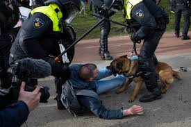 Dutch police break up anti-govt protest on eve of election