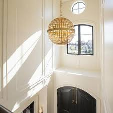 arched black front doors with gold globe pendant view full size chic two story foyer