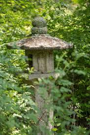 18th century japanese carved stone lantern with bas relief figures