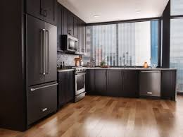 grey kitchen cabinets with black stainless steel appliances metal lummy new finish being offered curly after
