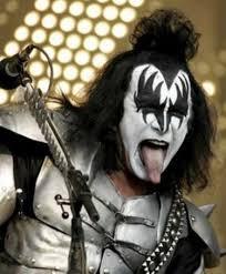 gene simmons tongue. trademark -demon makeup -axe-shaped bass guitar -long tongue gene simmons g