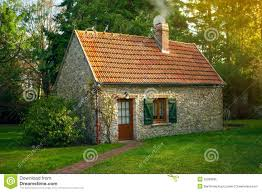 Beautiful Small Rustical Stone House With Garden At Sunny Summer Day