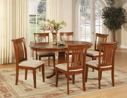 awesome oval dining table design plus arched window and traditional chairs feat rectangle area rug idea