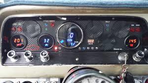 intellitronix gauges installed in custom instrument panel 64 chevy truck