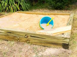 diy sand box converts to raised bed