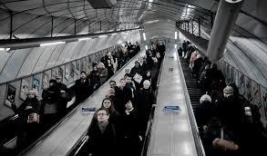 people on escalator. photo of people on an escalator o