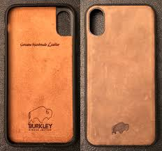 the case is constructed of an impact resistant polycarbonate infrastructure with a piece of well finished leather inlaid into the back of the case