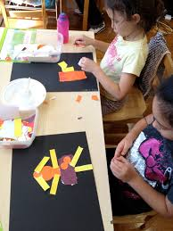Child Tearing Colored Paper Into L