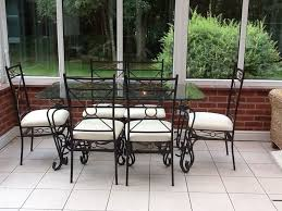 glass and wrought iron dining table with 6 chairs for in together with terrific dining