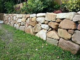 stacked stone retaining wall how to build a rock retaining wall sandstone retaining wall ideas build