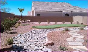 Decorative Rock Designs Desert Landscaping With River Rock Home Design Ideas 70