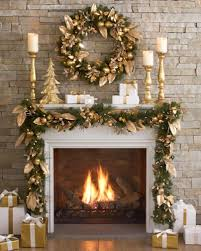 Gold and White HOliday decoration of fireplace mantle