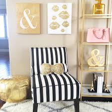 Striped armless black and white chair, gold pouf, sequin bow ...