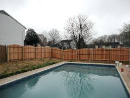 building a fence on uneven ground installing wood fence on uneven ground round designs install a wood fence on uneven ground