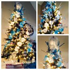 Whimsical blue, silver, and white themed christmas tree. With angel tree  topper,