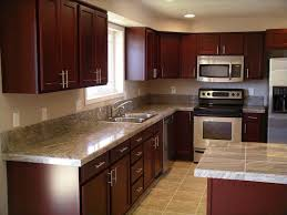 cherry kitchen cabinets with gray walls