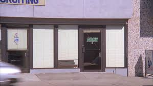 day raked left glass doors that read army mini blinds covering windows then pull back reveal u s armed forces recruiting military building