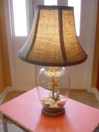 i filled my lamp with beach sand and shellade a burlap shade for it