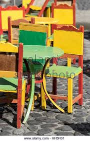 brightly painted furniture. caf patio furniture brightly painted el jardin stock image