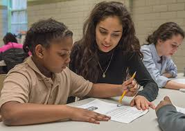 Teen Tutors Take Pride in Helping Younger Students During Math Power Hour -  Admissions - News | Fenwick High School