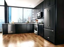 blue kitchen floor tiles red kitchen floor tiles rectangular kitchen tiles black kitchen appliances white cabinets