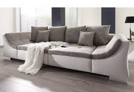 Intriguing Big Sofas On Wooden Flooring With Grey Cuhsions Made In Unique  Design With Grey Cushion