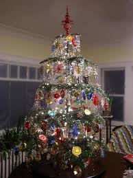 This tree is done with plastic ornaments and light covers from the 60s. I  did this one in 2003. I need a bigger house to do more trees!
