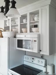spacesaver rustic kitchen design with wood wall mounted kitchen shelving uniticrowave shelf above stove under cabinet painted with white color ideas