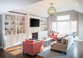 gray living room with pink chairs