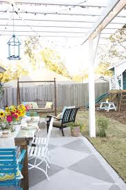 diy concrete patio cover ups lots of ideas tutorials including this tutorial from handmade home on how to paint concrete
