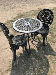 black metal garden bistro set the table is a good size and has a hole for the sun umbrella two chairs