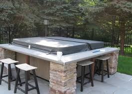Throw in a bar with accented seating around your hot tub.