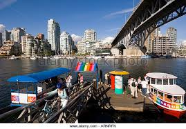 brightly colored water taxis on false creek vancouver british columbia canada brightly colored offices central st